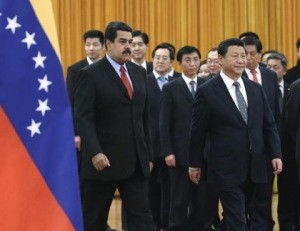Venezuela's President Maduro walks with China's President Xi as they arrive for a welcome ceremony at the Great Hall of the People in Beijing