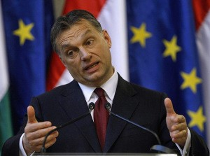 Hungarian Prime Minister Orban gestures at a news conference with European Commission President Barroso (not pictured) in Parliament at Budapest